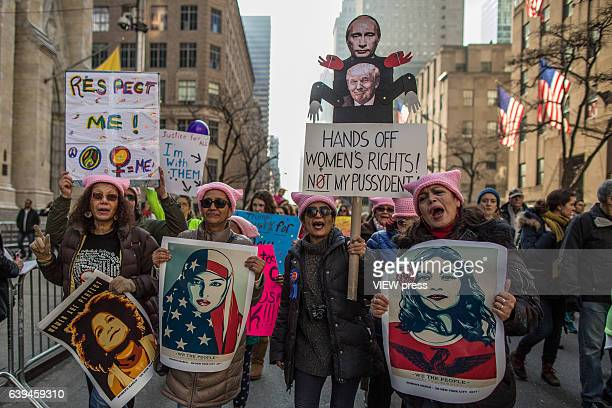 Demonstrators hold signs and chant during the Women's March in New York City on January 21 2017 Protesters in the United States and around the world...
