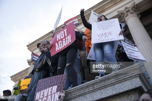 Demonstrators hold signs and chant on Pennsylvania Avenue during the March For Our Lives in Washington DC US on Saturday March 24 2018 Thousands of...