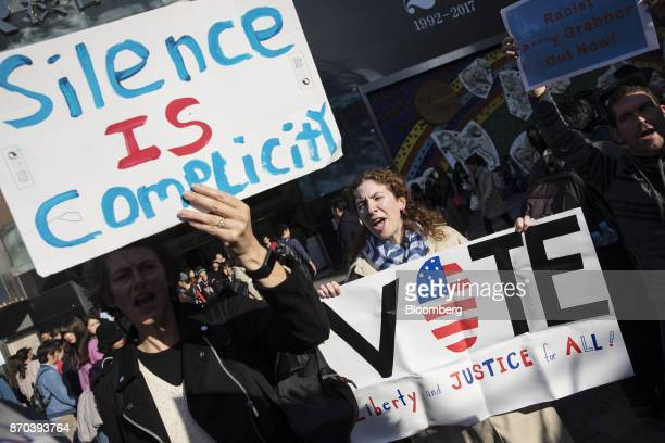 Demonstrators hold signs and chant slogans during a protest against US President Donald Trump in Tokyo Japan on Sunday Nov 5 2017 Trumpwarned...