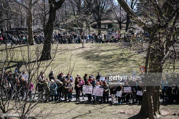 Demonstrators hold signs and gather in Central Park during the March For Our Lives in New York, U.S., on March 24, 2018. Thousands of high school...