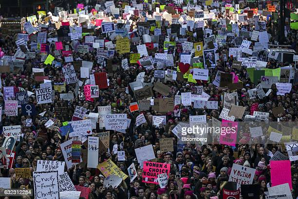 Demonstrators hold signs and march towards Trump Tower during the Women's March in New York, U.S., on Saturday, Jan. 21, 2017. Hundreds of...