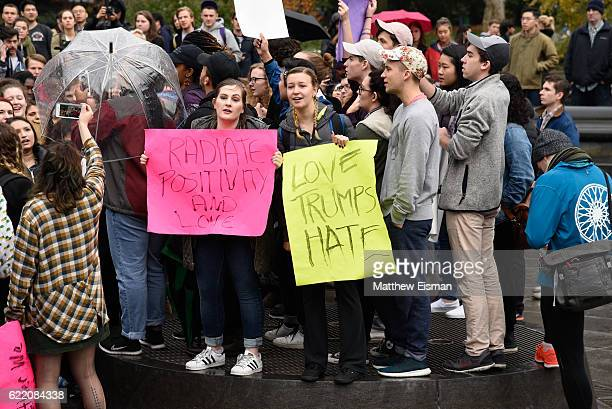 Demonstrators hold signs and protest against Donald Trump's presidency at Washington Square Park on November 9, 2016 in New York City.