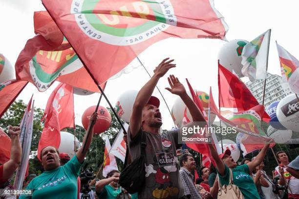 Demonstrators hold signs and shout slogans during a protest against pension reform in Sao Paulo Brazil on Monday Feb 19 2018 There may be a new twist...