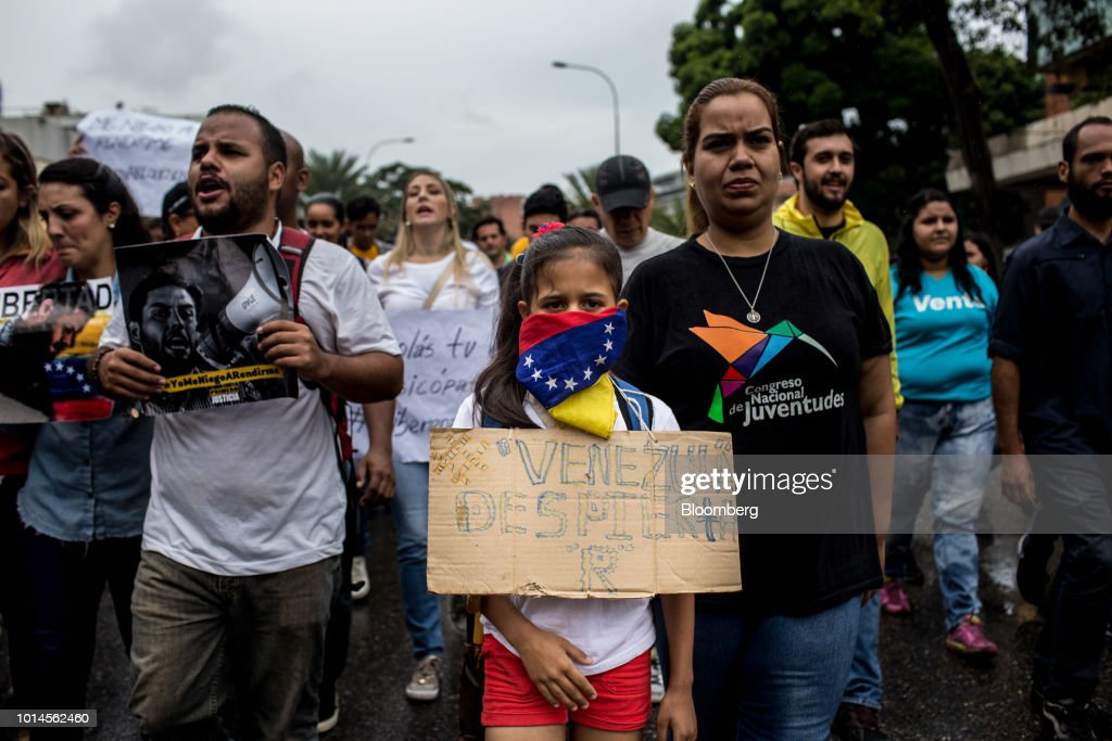 Demonstrators hold signs and shout slogans during a protest in front of the Organization of American States (OAS) headquarters in Caracas, Venezuela, on Friday, Aug. 10, 2018. Venezuelan President Nicolas Maduro launched a roundup of opponents in tandem with a security sweep in the wake of Saturday's explosive drone attack. Congressman Juan Requesens was arrested by intelligence police Tuesday evening and taken from his his east Caracas apartment, security camera footage showed. Photographer: Manaure Quintero/Bloomberg via Getty Images
