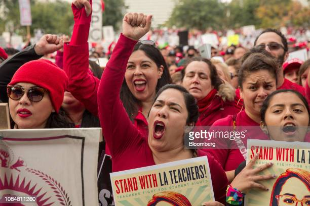 Demonstrators hold signs and shout slogans during a teachers strike in Los Angeles California US on Friday Jan 18 2019 Teachers in Los Angeles the...