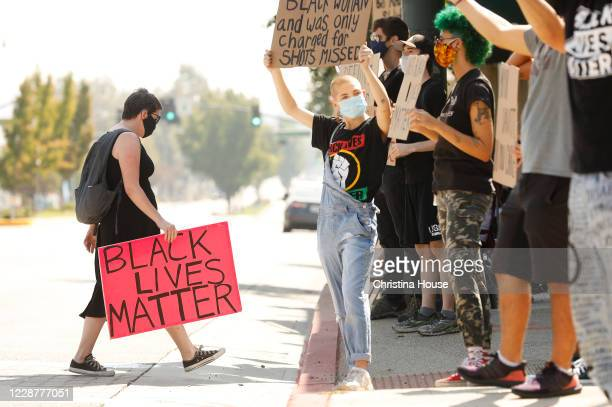 Demonstrators hold signs at the intersection of Foothill Boulevard and Angeles Crest Highway in La Cañada on Sunday September 27 2020 Protests...