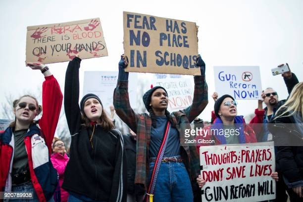 Demonstrators hold signs during a liein demonstration supporting gun control reform near the White House on February 19 2018 in Washington DC...