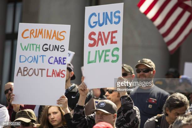 Demonstrators hold signs during a March For Our Rights progun rally outside the Washington State Capitol building in Olympia Washington US on...