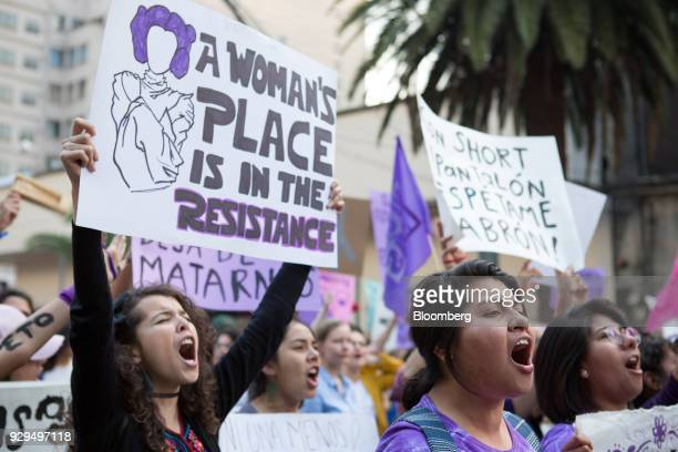 Demonstrators hold signs during a national strike on International Women's Day in Mexico City Mexico on Thursday March 8 2018 The United Nations...