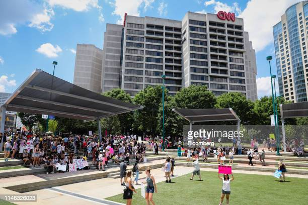 Demonstrators hold signs during a protest against Georgia's heartbeat abortion bill at Olympic Centennial Park in Atlanta Georgia US on Saturday May...
