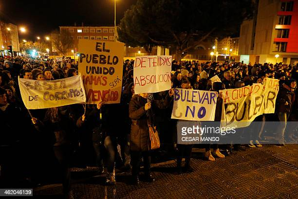 Demonstrators hold signs during a protest against imminent construction works to revamp Vitoria street the city's main thoroughfare in Burgos on...