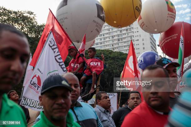 Demonstrators hold signs during a protest against pension reform in Sao Paulo Brazil on Monday Feb 19 2018 There may be a new twist in the fate of...
