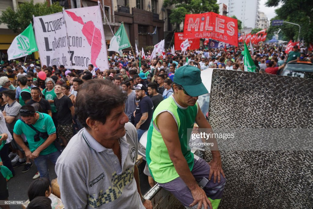 Demonstrators hold signs during a protest against President Mauricio Marci's economic policies in Buenos Aires, Argentina, on Wednesday, Feb. 21, 2018. Hugo Moyano, perhaps the most powerful union leader in the country, called the protest in a dispute over cuts to pension payments and dismissals as he heads for a showdown with Macri. The government claims it's a response to several allegations of corruption against Moyano. Photographer: Pablo E. Piovano/Bloomberg via Getty Images