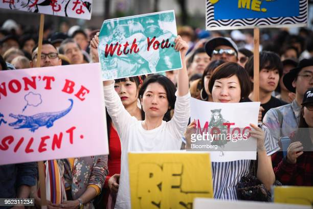 Demonstrators hold signs during a rally against sexual harassment in Shinjuku Tokyo on Saturday April 28 2018 Japan's finance ministry determined on...