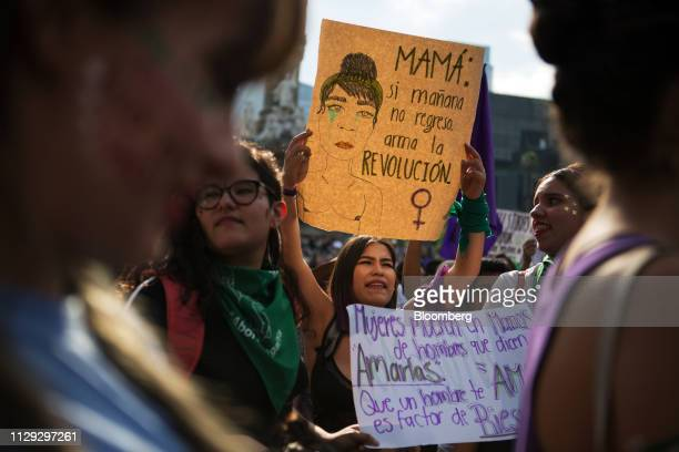 Demonstrators hold signs during a rally on International Women's Day in Mexico City Mexico on Friday March 8 2019 The United Nations first recognized...