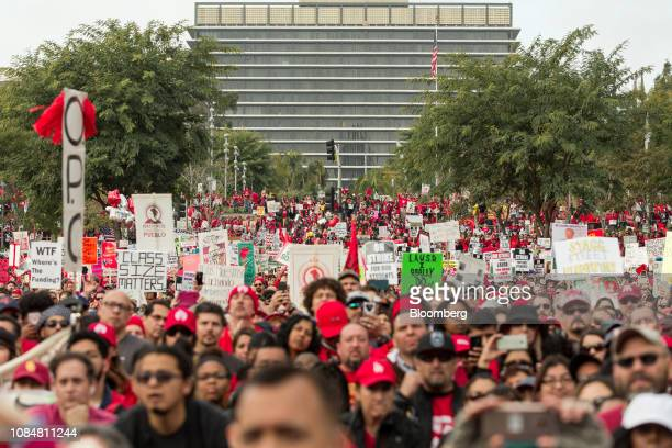 Demonstrators hold signs during a teachers strike in Los Angeles California US on Friday Jan 18 2019 Teachers in Los Angeles the secondlargest school...