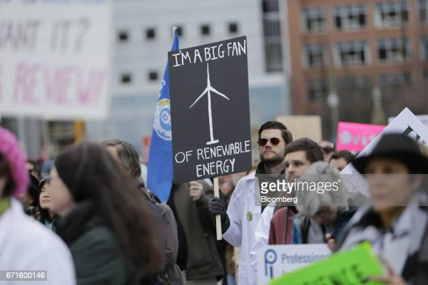 Demonstrators hold signs during the March for Science rally on Earth Day at Parliament Hill in Ottawa Ontario Canada on Saturday April 22 2017 The...