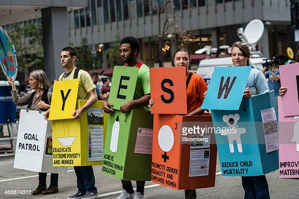 Demonstrators hold signs during the People's Climate March in New York US on Sept 21 2014 The United Nations 2014 Climate Summit is scheduled for...