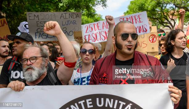 Demonstrators hold signs in a national anti-fascist rally from Rossio Square to Praça Camoes on August 10, 2019 in Lisbon, Portugal. Hundreds of...