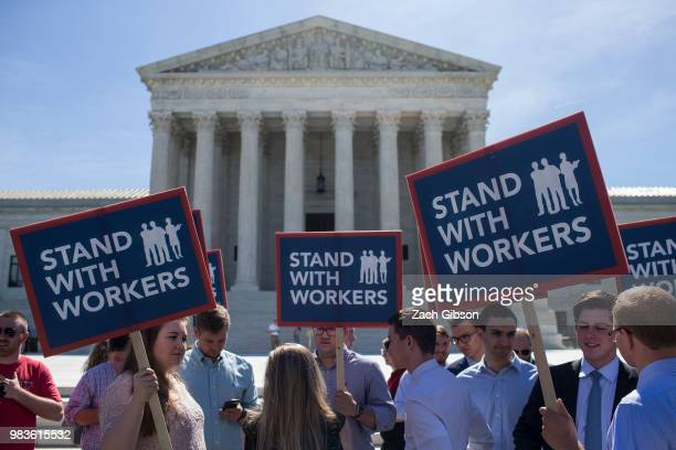 Demonstrators hold signs in front of the US Supreme Court on June 25 2018 in Washington DC The high court is expected to issue decisions in six...