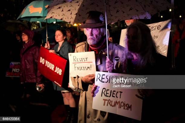 Demonstrators hold signs in Lafayette Square during a rally calling for resistance to President Donald Trump on February 28 2017 in Washington DC...