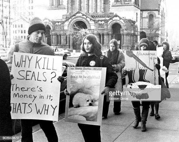 Demonstrators hold signs protesting the hunting of seals in Boston's Copley Square on Jan 12 1978