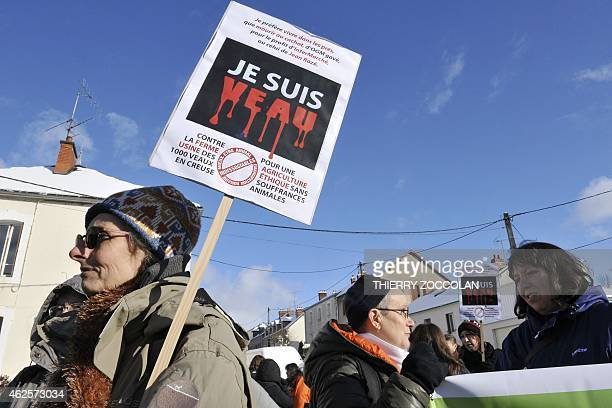"""Demonstrators hold signs reading """"I am calf"""" during a protest against the """"Ferme des 1,000 veaux"""" organized by the animal rights group """"Oui a..."""