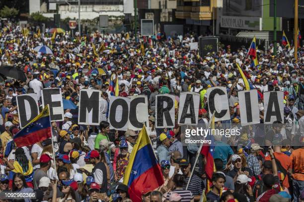 Demonstrators hold signs spelling Democracia during a proopposition protest in Caracas Venezuela on Saturday Feb 2 2019 Thousands of opponents of...