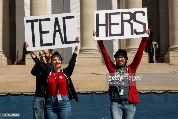 Demonstrators hold signs that read Teachers during a strike outside the Oklahoma State Capitol building in Oklahoma City Oklahoma US on Tuesday April...