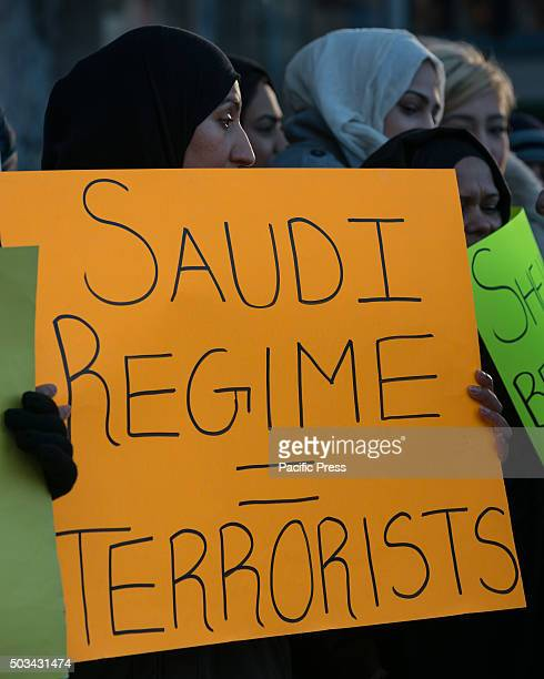 Demonstrators hold signs while demonstrating in Columbus Circle Several hundred MuslimAmericans from the New York City metro area rallied in front of...