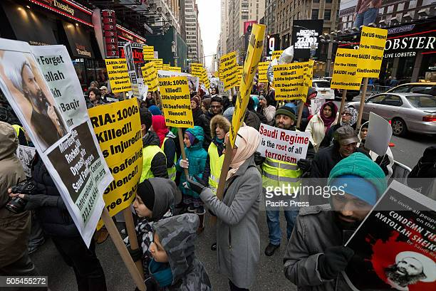 Demonstrators hold signs while participating in the Times Square rally Nearly 1000 members of the MuslimAmerican community from New York Illinois and...