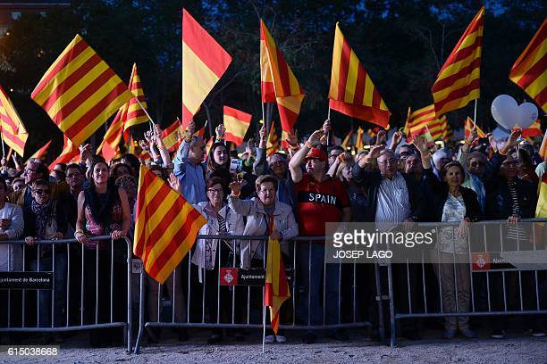 Demonstrators hold Spanish and Catalan flags during a demonstration called by 'Sociedat Civil Catalana' to support the unity of Spain under the...