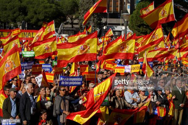 Demonstrators hold Spanish flags and placards reading 'not to the impunity of the coup plotters' as they protest in support of Article 155 and...