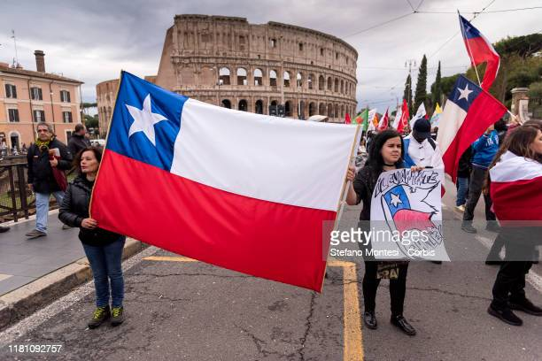 Demonstrators hold the flag of Chile in the national demonstration against the racism and the Security Decree wanted by former Interior Minister...