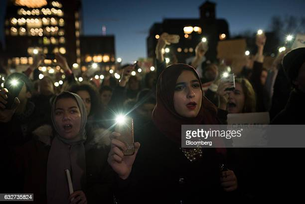 Demonstrators hold their mobile phones with flashlights switched on as they gather during a Council on AmericanIslamic Relations news conference in...