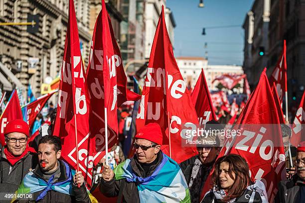 Demonstrators hold trade unions flags during a Public Sector workers demonstration to protest against Italian government in Rome Thousands of Public...