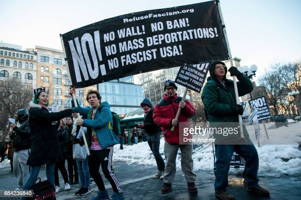 Demonstrators hold up a banner during a protest of President Donald Trump's proposed travel ban and suspension of the country's refugee program March...