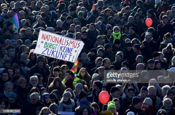 Demonstrators hold up a sign written with 'Nationalism harbors no future' during a protest against the ENF congress in Koblenz Germany 21 January...