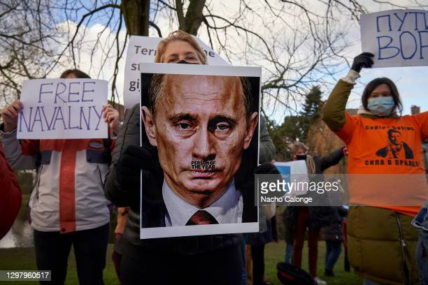 Demonstrators hold up banners in front of the Russian embassy in the Netherlands in support of Russian dissident Alexei Navalny and against President...
