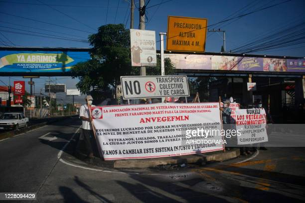 Demonstrators hold up banners while chanting slogans for the payment of veterans pensions during a veterans protest from the former guerrilla Frente...