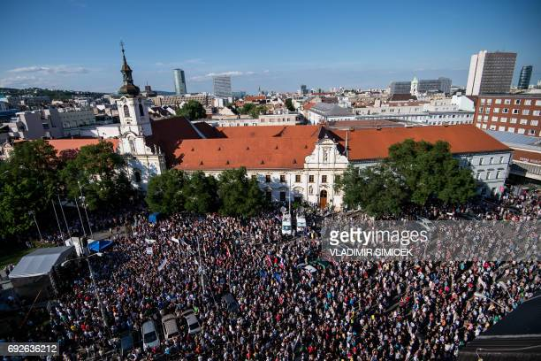 Demonstrators hold up flags of Slovakia and EU during an anticorruption rally in Bratislava Slovakia on June 5 2017 Thousands of protesters joined a...
