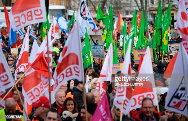 "Demonstrators hold up flags of the IG BCE industrial trade union and of the Green party as they rally for a protest themed ""Not with us! No pacts..."