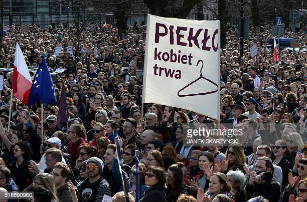 Demonstrators hold up hangers symbolizing illegal abortion during a protest against a possible tightening of the countrys abortion law already one of...