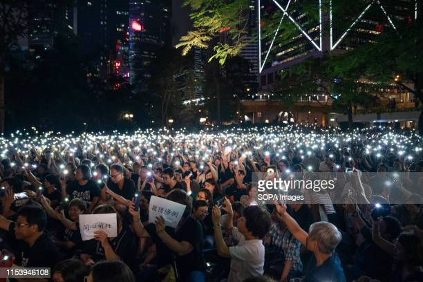Demonstrators hold up lights from their phones during the rally Thousands of demonstrators join a rally organised by the Hong Kong mothers in support...