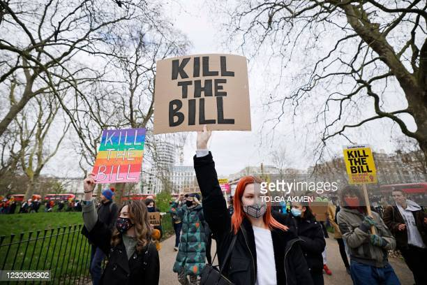 Demonstrators hold up placards as they take part in a 'Kill The Bill' protest against the Government's Police, Crime, Sentencing and Courts Bill, at...