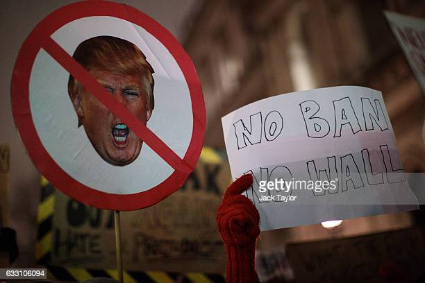 Demonstrators hold up placards during a protest outside Downing Street against US President Donald Trump's ban on travel from seven Muslim countries...