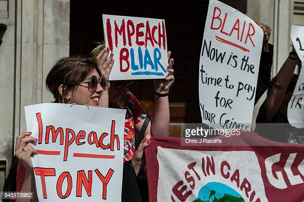 Demonstrators hold up placards outside the Queen Elizabeth II conference centre on July 6, 2016 in London, England. The Iraq Inquiry Report into the...