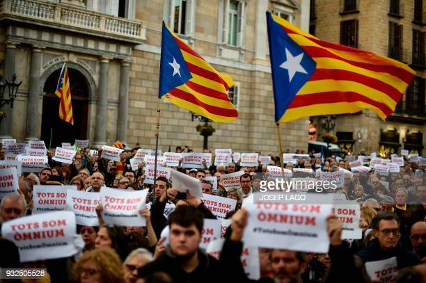 Demonstrators hold up posters reading 'We all are Omnium' during a demonstration called by Omnium Cultural to demand a Catalan republic at Sant Jaume...