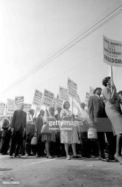 Demonstrators hold up signs as they participate in the March on Washington for Jobs and Freedom Washington DC August 28 1963 Among the visible signs...