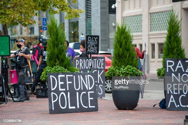Demonstrators hold up signs in protest at the Hamilton County Courthouse following the Breonna Taylor decision earlier in the day in Louisville,...
